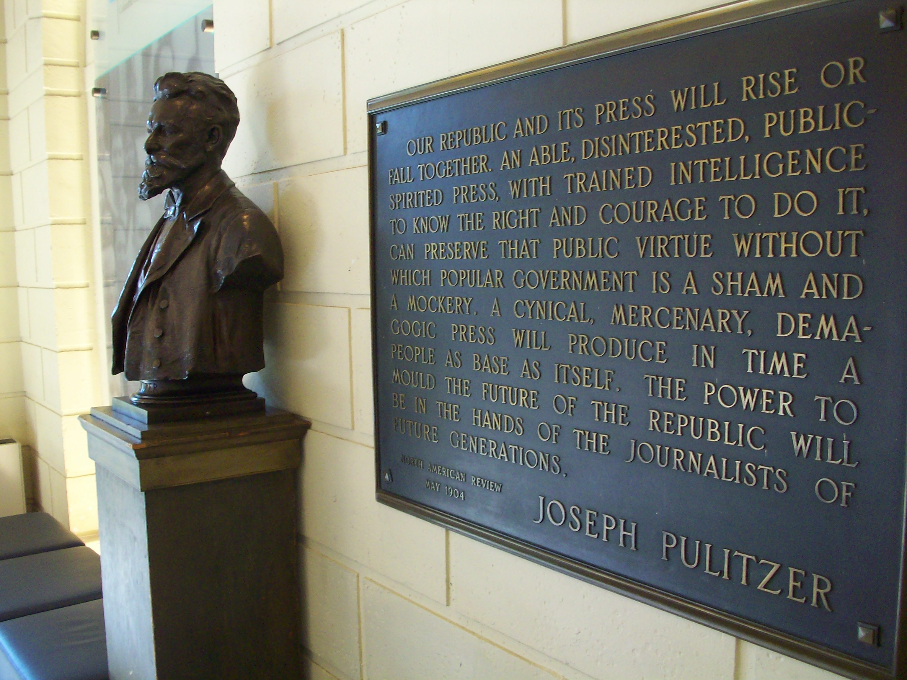 Joseph Pulitzer's bust stands next to a plaque bearing his words in the lobby of Pulitzer Hall, which houses the Columbia University Graduation School of Journalism. (Picture via Matt Drange)